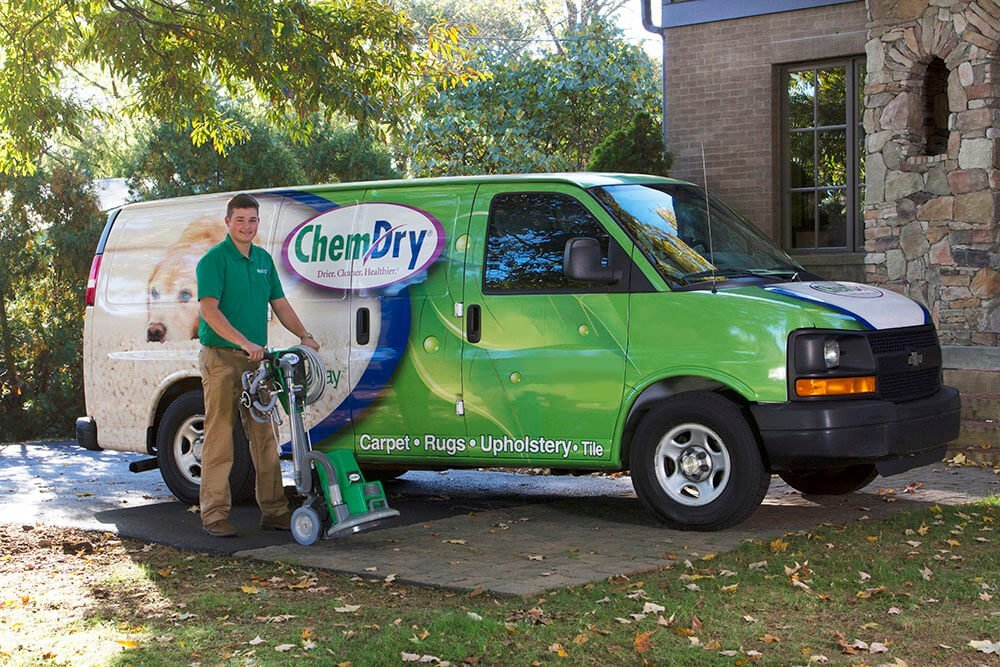 Freshen Up Chem-Dry service van and technician preparing for carpet cleaning service